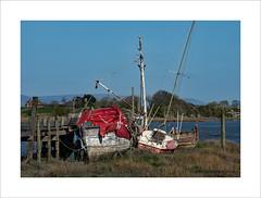 Moored (prendergasttony) Tags: mooring moored boats river tarp sheet red nikon d7200 riverwyre lancashire england gonefishing tarpaulins mast rigging beached grass post rope muddy tributary creek woodenhull berth skippoolcreek