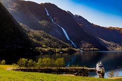 Langfossen (langdon10) Tags: mountains norway water calm fjord reflections rock ship shoreline waterfall langfossen