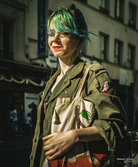 Street - Greenish (François Escriva) Tags: street streetphotography paris france people candid olympus omd photo rue woman colors sidewalk green red bag cherry ghostbuster smile hair building belleville fashion mode army jacket sun light lips