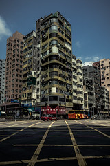 Sham Shui Po, Hong Kong (Piotr_PopUp) Tags: laichikok namcheong shamshuipo kowloon hongkong buildings street road taxi red modernist architecture urban city cityscape asia