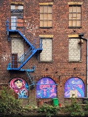 Zig Zag Blue (Mr_Pudd) Tags: ashtoncanal vegetation urbandereliction urbandecay cinderblock breezeblock redbrick manchester milesplatting graffiti artwork doors windows canal bin iphone zigzag fireescape mill brick