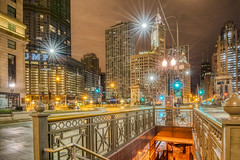 In the Center of It All (tquist24) Tags: chicago hdr hff illinois michiganavenue nikon nikond5300 wrigleybuilding city cityscape downtown fence geotagged lights longexposure night outside sky skyscraper skyscrapers starburst streetlight color colorful light street