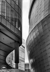 Between (allentimothy1947) Tags: califonia chasecenter dumbo sanfrancisco blue buidings construction lifts metal sky walkways work manicaarchitecture bw arena multiuse reflection goldenstatewarriorshome