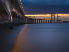 When the sun comes crashing (Wizard CG) Tags: tags high tide shade 10 welding glass landscape second severn crossing the south west uk bridge bristol channel coast coastal landmark long exposure rocks water river seascape sunset hdr ngc world trekker micro four thirds 43 m43 olympus mzuiko digital ed architecture tourist attraction outdoor sky