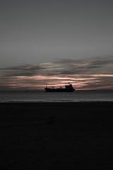 #280419 - Sobre la mar (RomxnJota) Tags: boat barco sunlight sunset sun mar mediterráneo cloudy nubes puesta de sol cielo sky grey gris beach playa paisaje 1855mm canon 77d arena nature naturaleza sand