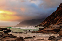 Glowing At Sunset (david.gill12) Tags: hues sunset clouds reflections sea rocks beach outdoors