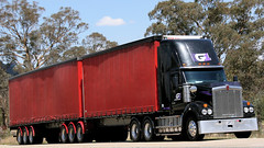 Uphill Black KWs (2/2) (Jungle Jack Movements (ferroequinologist)) Tags: black grey jaricks wagga g1 logistics kenworth w900 trss binalong nsw new south wales australia hume highway hp horsepower big rig haul haulage cabover trucker drive transport carry delivery bulk lorry hgv wagon road nose semi trailer deliver cargo interstate articulated vehicle load freighter ship move roll motor engine power teamster truck tractor prime mover diesel injected driver cab cabin loud rumble beast wheel exhaust double b grunt bowning