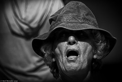 OMG – Oh My God! (Neil. Moralee) Tags: neilmoralee norway2015neilmoralee woman hat shock startles surprised surprise astounded face old mature lasy openmouthed open mouth black white mono monochrome bw bandw blackandwhite blackwhite neil moralee candid norway sunshine sun bright brite shadow harsh portrait