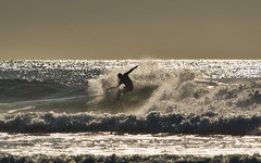 Sunset Surfing Off oregon Coast (Ray Mines Photography) Tags: bandon beach oregon surf surfer waves tubs riding crest evening sunset ocean water ripcurl tide board wetsuit spray foam sand sea travel outdoors scenery