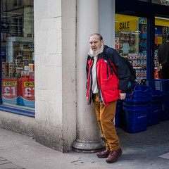 Halifax 010 (Peter.Bartlett) Tags: olympusomdem1 eyecontact window unitedkingdom people streetphotography doorway westyorkshire peterbartlett man urban candid uk m43 microfourthirds shopwindow sign standing halifax england