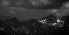 Dramatic Light (Frédéric Fossard) Tags: alpenglow mood moodysky dramaticsky cloud nuage sky ciel paysage mountain montagne landscape mountainscape neige snow névé cimes crêtes arêtes alpes hautesavoie monochrome noiretblanc blackandwhite lumière light shadow ombre atmosphère dramatique naturesauvage massifdesaiguillesrouges vallon valley mountainpeak mountainridge mountainrange