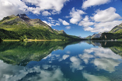 Lej da Segl reflections (Tjaldur66) Tags: peaks lake lakeshore lakeside reflections clouds water mountains swissalps engadin highvalley valley summer summerclouds travel switzerland sils landscape scenery tranquility alpine