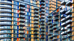 Busy Living (DobingDesign) Tags: residential apartments highrise storeys colours redblueyellow cladding balconies london residentialarchitecture lines floors architecture modernarchitecture angles stack resi levels rows pattern repeatingpattern