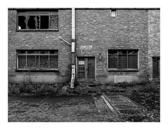 170930_171727_oly-PEN-f_heusden-zolder_de schacht_1/9 (A Is To B As B Is To C) Tags: aistobasbistoc b belgië belgium heusdenzolder deschacht schachtplein magazijnstraat steenkoolmijn koolmijn industrial industry industrialheritage olympus penf bw blackwhite blackandwhite monochrome brick brickwork architecture facade building windows pipe limburg