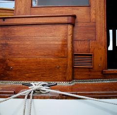 Bristol fashion (sailronin) Tags: yacht woodenboat varnish perfection cleat mooringlines film kodakportra160 rolleiflex6008 analog lakeunion seattle lake union drydock centennial