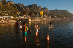 Cape Town, South Africa (f.d. walker) Tags: africa capetown southafrica people person park streetphotography street sunlight sun surreal sky sea candidphotography candid color colorphotography city bathing suit beach sand water moutains camps bay