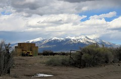 The Open Gate (Patricia Henschen) Tags: blanca massif sanluisvalley clouds storm ranch hay tractor gate rural mountain mountains sangredecristo alamosa colorado backroad spring snow snowcapped