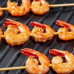 Grilled shrimp tails on black background thumbnail