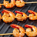 Grilled shrimp tails on black background