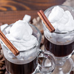 Two glass cups of coffee with whipped cream thumbnail