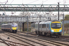 Transpennine 185121 and Grand Central 180107 - Doncaster (Neil Pulling) Tags: doncasterstation doncaster southyorkshire eastcoastmainline ecml train transport railway 180107 185121