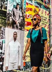 Street - Girl and boys (François Escriva) Tags: street streetphotography paris france people candid olympus omd photo rue woman colors sidewalk sun light billboard poster sunglasses black green orange yellow white pretty cute wall