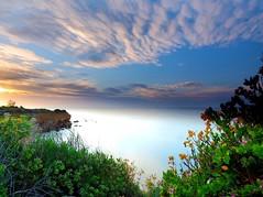 Little taste of Heaven. Mt Eliza. Victoria - Australia (rosgloryfire) Tags: public cloudstack color australia bay scenic reflections rocks dusk water olympus moodyskies clouds skydrama goldenhour sunset sun sea sky nature landscapes nisifilters seascapes longexposure