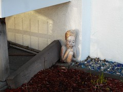Not Creepy at All (navejo) Tags: montreal quebec canada garden statue creepy bust shadow fence