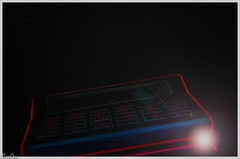 Der Taschenrechner / The calculator (Reto Previtali) Tags: licht light red rot nikon flickr dark dunkel decoration design night nikkor blue blau fog gold happy analog pentax event macro nah cute life