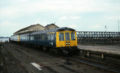 Class 114 DMU @ New Holland Pier, Lincolnshire, August 1980 [slide 8074] (graeme9022) Tags: derby heavyweight heavy weight 56006 54006 e54006 british rail railways br blur plain standard corporate livery lincoln uk train station railcar service travel paytrain pay diesel mechanical multiple unit local regional low density passenger transport transportation humber crossing wooden platform