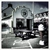 Lick'd (Explored) (Julie (thanks for 8 million views)) Tags: kilmorequay bench takeaway ireland irish wexford building bw monochrome squareformat table seaside iphonese 100xthe2019edition 100x2019 image55100 street icecreamcone advertising door window hbm benches windows wall hww inexplore