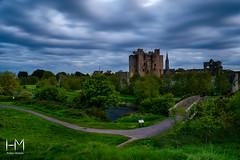 Trim Castle (Helen Mulvey) Tags: trim castle landscape landmark sunset outdoor ruin leading lines river cloud nikon d5100