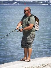 Fisherman in camo cargos (LarryJay99 ) Tags: cargo cargopants camouflage camo man men guy guys dude male studly manly dudes handsome people virile bear backpacker urbanbackpacker flipflops bareness barefoot toes headtotoe watersedge fisherman fishing