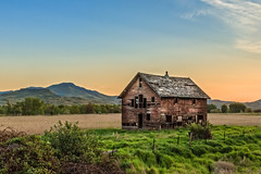 An Old Homestead (http://fineartamerica.com/profiles/robert-bales.ht) Tags: emmett facebook fineart flickr haybales idaho people photo photouploads places states barn sunrise sunset house farm homestead ranch cattle barnwood fence butte squawbutte mountain idado landscape treasurevalley gemcounty scenicbiway americaphotography valley idahophotography beautiful sensational spectacular magnificent surreal sublime magical spiritual inspiring canonshooter scenic wow stupendous superb building grass hay trees yellow blue robertbales sky railroad tracks panoramic pano