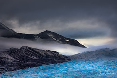 Grey in the Mist (Jerzy Orzechowski) Tags: patagonia landscape mist mountains glacier lagogrey blue snow reflections rocks light chile torresdepaine fog yellow clouds ice
