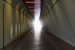 Toward the Light (Robin Shepperson) Tags: light explosion tunnell architecture red modern berlin germany tegek airport walkway pedestrian d3400 nikon composition lines length