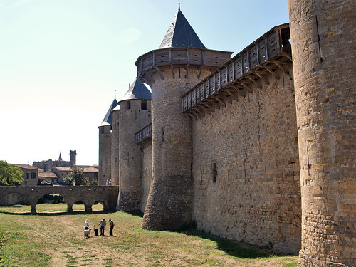 Château Comtal with ramparts and its own moat within the walls of 'La Cite', Carcassonne, France.