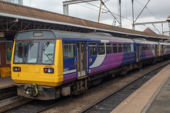 Northern 142032 (Mike McNiven) Tags: arriva railnorth northern dmu diesel multipleunit pacer manchester oxfordroad deansgate liverpool limestreet