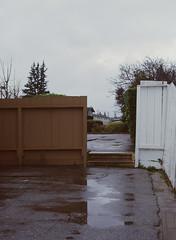 Sunnyvale, California (bior) Tags: pentax645nii pentax645 6x45cm ektachrome e200 kodakektachrome slidefilm mediumformat 120 sunnyvale street fence parkinglot rain suburbs