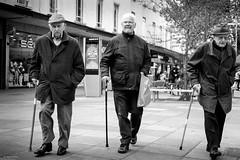 3 Old Sticks (Silver Machine) Tags: portsmouth hampshire streetphotography street candid candideyecontact men walking walkingstick flatcap mono monochrome blackwhite bw fujifilm fujifilmxt10 fujinonxf35mmf2rwr
