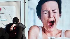 Tired (Guido Klumpe) Tags: werbung advertise gähnen jawn müde tired lustig funny juxtaposition candid street streetphotographer streetphotography strase hannover hanover germany deutschland city stadt streetphotographde unposed streetshot gebäude architecture architektur building perspektive perspective