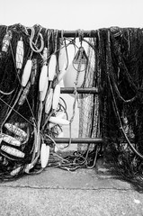 Hung out to dry (Richie Rue) Tags: fishing nets drying floats nautical seaside monochrome blackandwhite bnw film analogue 35mm foma fomafomapan200 minolta x300 caffenol homebrew ishootfilm istillshootfilm filmsnotdead mindfulphotography contemplativephotography