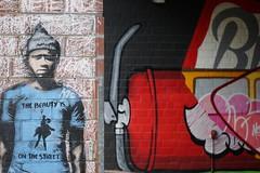 Street Art Berlin (Sascha Klauer) Tags: art backstein backsteinmauer backsteinwand berlin bülowstrase einfahrt feuerlöscher gemälde graffiti junge kunst mann mütze streetart streetartberlin thebeautyisonthestreet deutschland germany boy