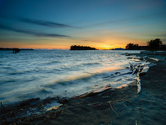 P0000342 South Dyke Road Sunset - 06-May-2019 (f/13 photography) Tags: richmond bc vancouver sunset shoreline seascape tides waves logs wind motion movement beach steveston wood trees dyke road gilbert south british columbia canada phase one xf schneider kreuznach blue ring 35mm 3535 f35 wide angle super dof long exposure rrs tripod arca swiss p0 hybrid haida filters filter gnd nd lee sw 150 ii