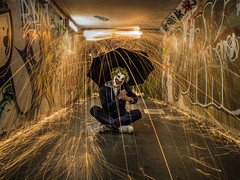 people think i'm strange i wonder why (Wizard CG) Tags: steel wool spinning light painting long exposure night photography sparks lawrence hill bristol wire wirewool hate clown nite nuts fire dark digital underpass subway lighting olympus epl7