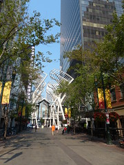 Metal Trees and Green Ones (Marit Buelens) Tags: canada alberta calgary stephenave avenue street building skyscraper art plant tree thetrees shoppingcenter plus15 skywalk 7thave stephenavenuewalk