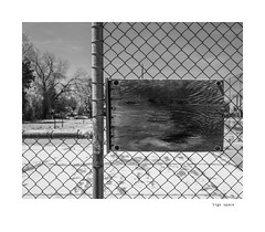 Sign Space (agianelo) Tags: chain link fence plywood board weathered monochrome bw bn blackandwhite