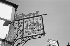 Douglas Arms (bigalid) Tags: film 35mm vivitar mega 200 ilford xp2 c41 bw april 2019 scotland castledouglas hotel sign