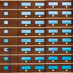 Detroit Geometry (David M Strom) Tags: abstract olympusem1markii davidstrom olympus12100 windows reflections architecture