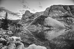 Moraine Lake diamond (John Andersen (JPAndersen images)) Tags: alberta banff clouds morainelake silhouettes sunrise trees wenkchemna